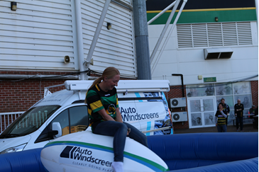 Female fan riding a rodeo ball at Franklin's Gardens