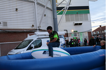 Fan riding a rodeo ball at Franklin's Gardens